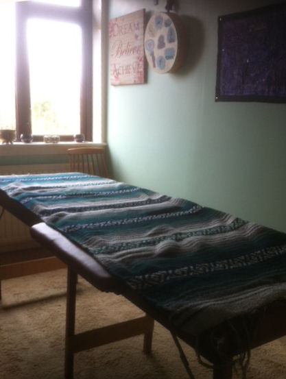 Therapy room with massage bed